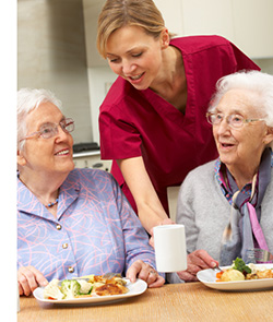 Residential Care Nurse with Two Older Ladies